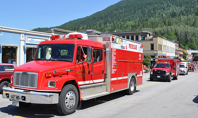 As usual, the Fire Rescue Service trucks and the ambulancewere among the last participants in the parade. David F. Rooney photo