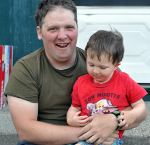 Cory and his son Clifford pose for a photo in the backyard of their home on Viers Crescent. David F. Rooney photo