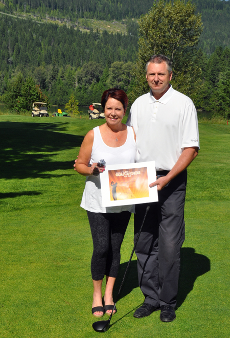 John Franks, the Revelstoke Golf Club's resident pro, poses with Wendy Toyer, executive director of the ALS Society of BC, as she presents him with a certificate of appreciation for his support of the organization. On June 20 John raised $1,200 for the society by playing 189 consecutive holes. John has done this before, but never has played quite that much golf in one day. Kudos, John, kudos. David F. Rooney photo