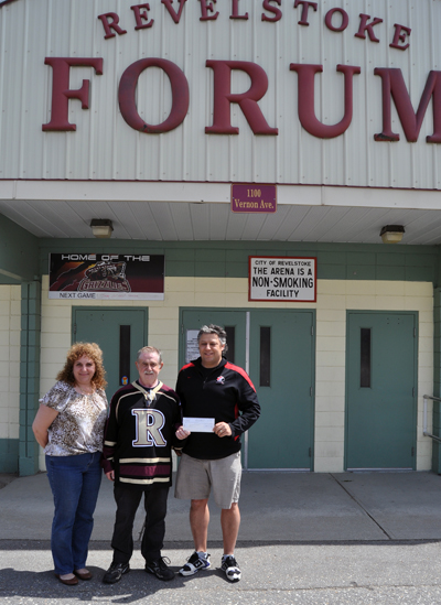 Renee Howe and Dennis Berarducci pose with Revelstoke Minor Hockey's Kevin Grim who is holding the $20,000 cheque that was won this spring through Kraft's Hockey Goes On Contest. Renee was instrumental getting Dennis nominated as Revelstoke's go-to hockey guy. Everyone knows that hockey can be an expensive sport and Kevin said the money will be used to help defray some of the costs families bear. David F. Rooney photo