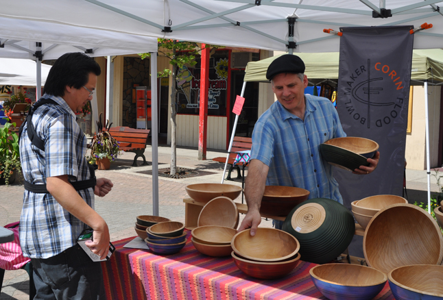 Wooden bowls have become something of a specialty for Corin Flood. He enjoys making them and, of course, selling them to, as you can see here s offers a few different ones for Steven Hui's consideration. You can see more Corin's creations in wood at http://corinflood.ca/. David F. Rooney photo