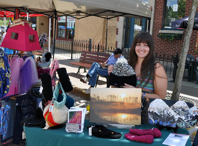 Amanda Raccah, knitter extraordinaire, shows off some the wares  she is selling at the Farmer's Market. Amanda sells her creations there as well as at a number of other venues, including Sangha Bean Cafe. You can discover more about her online at https://www.facebook.com/amanda.raccah?fref=ts. David F. Rooney photo