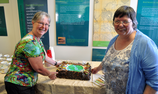 City Councillor Linda Nixon and Curator Cathy English show off the soon-to-cut-and-devoured MOSAIC cake baked by the Modern. It really was delicious! David F. Rooney photo