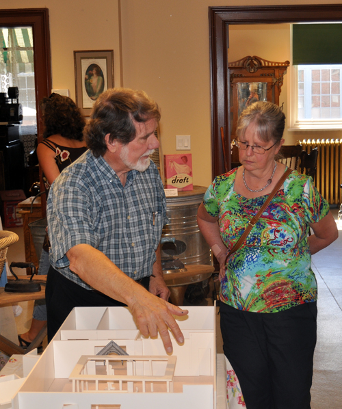 Museum designer Cyler Page of Vernon shows City Councillor Linda Nixon one of his visions for the future: series of permanent exhibitions along the outer walls of the main room with a a central exhibition space for one-of-a-kind local — or small visiting — exhibitions in the centre. Other displays could also installed upstairs. Cuyler designed the Kamloops Museum and worked at the Vancouver Art Gallery and the Royal BC Museum in Victoria. David F. Rooney