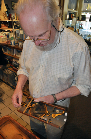 David Evans shows the internal mechanism of a rarely seen cycloidotrope, which he described as a kind of 19th Centurt Etch-a-Sketch. David F. Rooney photo