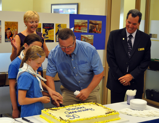Gary Starling had the honour of making the first slice on the cake. David F. Rooney photo