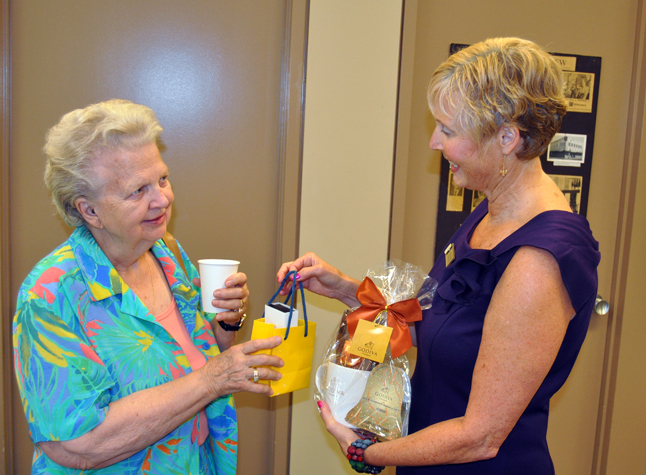 Ruby Cameron received a few gifts from Lynne Welock for having an account with the branch for 45 years. David F. Rooney photo