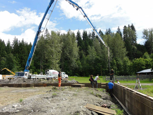 Once forms were laid for the foundation a cement truck was brought in. Photo courtesy of Tanya Secord