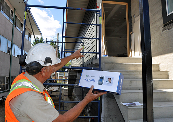 Want to know who's at your door before you open it? Builder Peter Bernacki talks about the Comelit HFX-720M colour intercom that will be installed in the house. David F. Rooney photo