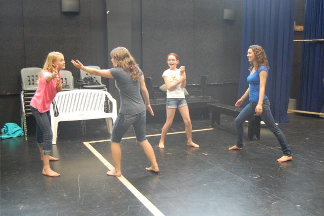 (Left to right) Frankie Howe, an unidentified actress, Isobel Bray and Hailey Christie-Hoyle practice their roles at the Midsummer Night's Dream workshop at the Revelstoke Performing Arts Centre on Monday. Laura Stovel photo
