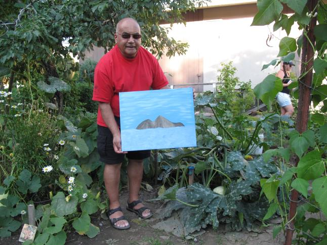 """I had a dream,"" said Satish Shonek, ""that Mount Begbie was an island."" This painting is called Begbie Island.  Satish Shonek has only recently taken up painting. laura Stovel photo"
