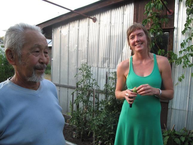 Gardener and wood artist Ken Sakamoto enjoys a laugh with NCES garden tour organizer Hailey Ross. Laura Stovel photo