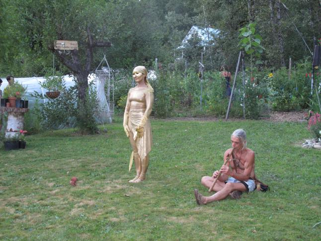 Gardener Sarah Harper is also a talented actor. Here she does performance art with Peter Oosterhof, who plays the flute. laura Stovel photo