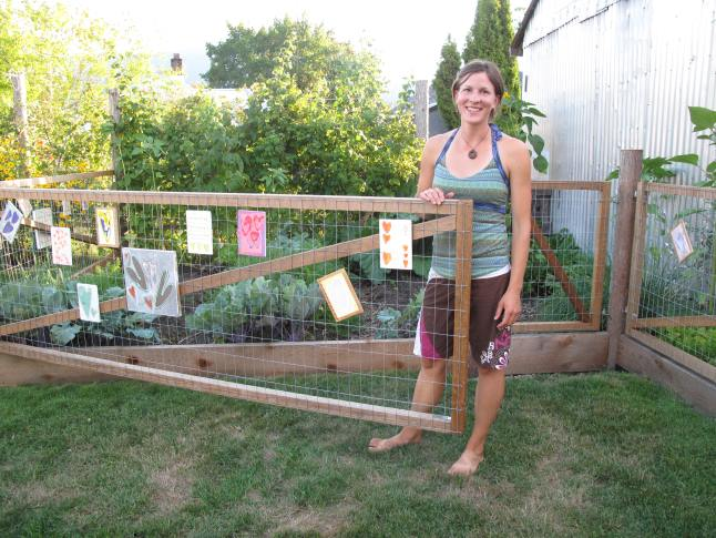 Natalie Stefl (pictured here) and her partner Jeff Ferguson have a very well organized small garden. Here, Natalie demonstrates the fact that the garden fences are actually gates that can be opened for easy access.  The garden was beautifully decorated with the paintings of Stephanie Lynn. Laura Stovel photo