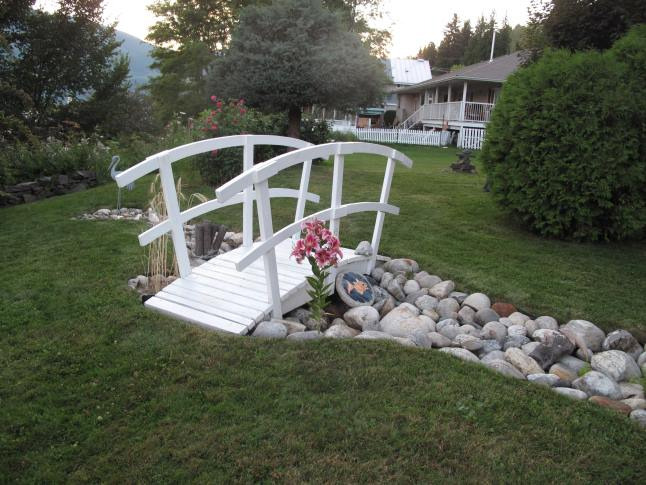 "Jean Takkinen's garden features a bridge that was built by a friend of her son. Unfortunately, Jean could not be here for the tour but she posted a note: ""So of course I had to create a creek bed to put the bridge over."" Laura Stovel photo"