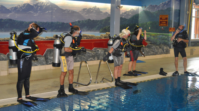 With their fins on and their masks on their faces the novice divers are ready to enter the water. David F. Rooney photo
