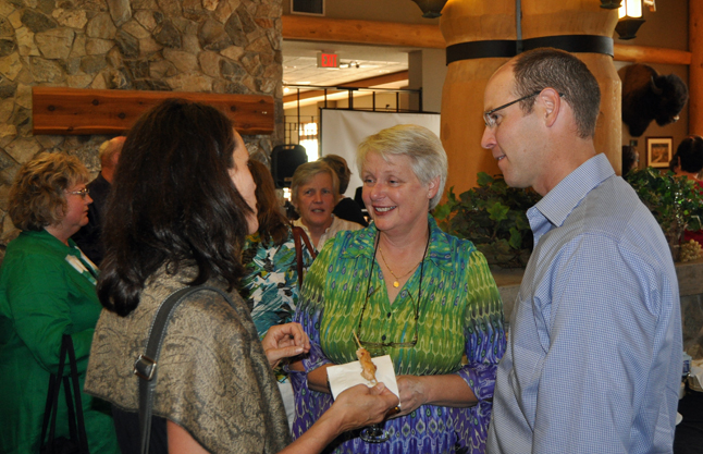 Anne Cooper (center) chats with teachers Eleanor and Jeff Wilson at the farewell party held for her at the Hillcrest Hotel. David F. Rooney photo