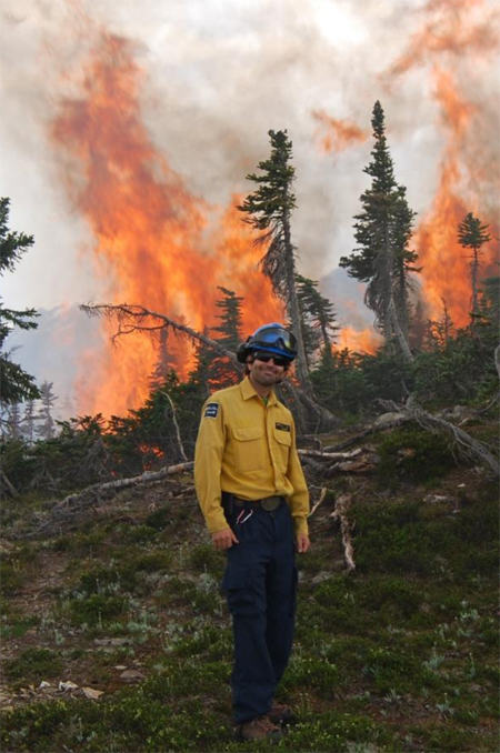 Simon Hunt, Parks Canada Fire Management Officer, oversees the work done by crews and is pleased at the progress. Simon takes and uses photos to document fire activity and fire management — he shares some of these with the public in order to increase understanding of Parks Canada fire management practices. Dave Smith/Parks Canada photo