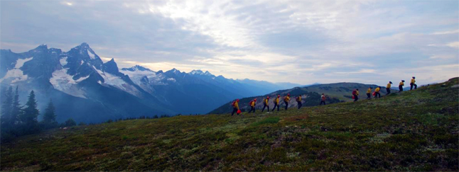 At the end of a long work day, the Parks Canada fire crew heads home. The crew for this fire is a combination of initial attack fire crews from Jasper National Park, Kootenay National Park, Mount Revelstoke and Glacier National Parks. Simon Hunt /Parks Canada photo