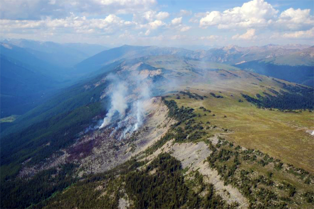 A lightning-caused fire spreads out of the Beaver Valley towards the Bald Hills. Simon Hunt /Parks Canada photo