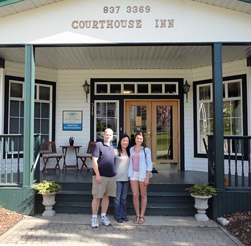 Revelstoke's Courthouse Inn is one of the businesses that has benefited from Columbia Basin Trust's School Works Program. In this innkeepers Shawn and Young Seon Cook pose with student employee Rayne Kramer. Photo courtesy of the Columbia Basin Trust