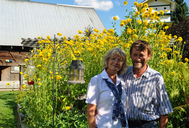 Martha and David Fehr have created a well-mannered garden in the back yard of their bed & breakfast, 7 Acres B & B, on Big Eddy Road. David F. Rooney photo