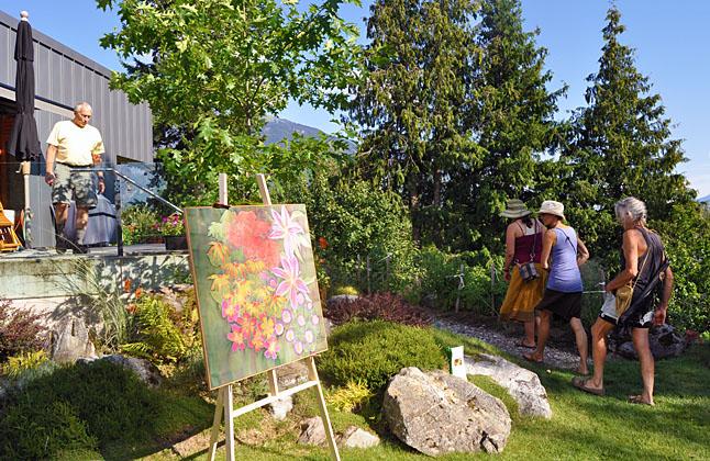 Geoff Battersby welcomes a group of people enjoying the Garden & Art Tour. Geoff and his wife Gwen have a lively vegetable garden and magnificent rock gardens. David F. Rooney photo