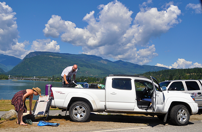 A couple packs up and prepares to leave Revelstoke at the conclusion of the annual Glacier Challenge Slow Pitch Tournament. They survived (very unusual)  torrential downpours and heavy thunderstorms but had a lot of fun. David F. Rooney photo