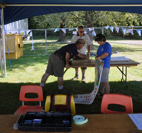 Rotarians Brett Renaud, Malcolm Bott and Pam Doyle were busy taking down the Rotary Club's tent on Monday morning. David F. Rooney photo