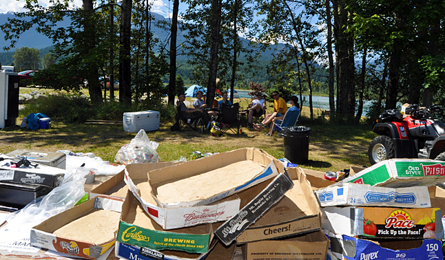 Revelstoke Ski Club volunteers take a well-deserved break at noon on Monday after spending their morning hours bagging thousands of recyclable cans at the Centennial Park ballfields. This is a major money-maker for the club. When all is said and done it will likely earn about $6,000 or $7,000 to support its winter ski programs. David F. Rooney photo