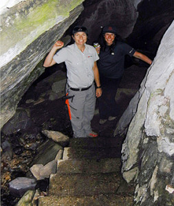 Alice Weber (left) and Sarah Boyle pose on the steps leading down into the Nakimu Cave system in Glacier National Park. Mandy Kellner photo courtesy of Parks Canada