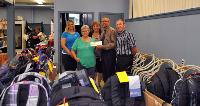 Revelstoke Credit Union staff demonstrated their sense of civic responsibility Friday, August 23, when they donated 40 backpacks including basic school supplies for school-aged children from economically disadvantaged families. Tina Russell (left), Renee Howe, Wes Groen and Randy Driediger also gave Patti Larson, coordinator of the Community Connections Food Bank, a cheque for $89 raised from popcorn sales during last weekend's outdoor movie at Centennial Park. David F. Rooney photo