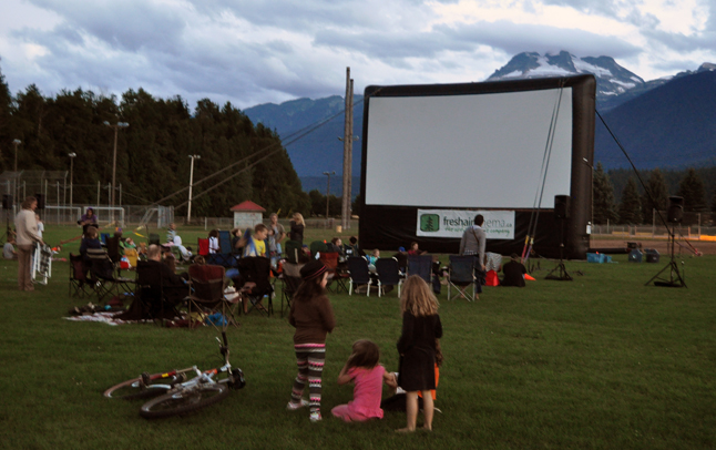 Rain clouds scudding across the sky probably had an effect on the Revelstoke Credit Union's showing of the animated comedy Hotel Transylvania. The crowd eventually got larger and the movie even started at 9:10 pm despite three brief showers. David F. Rooney photo