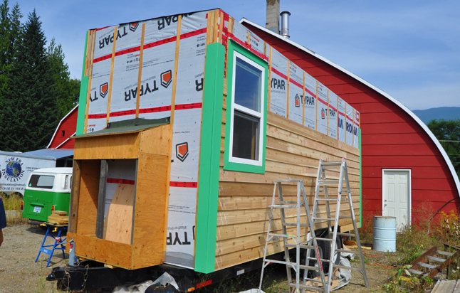 The roof is, of course but they've still got some work to do on the exterior of their micro-house. David F. Rooney photo