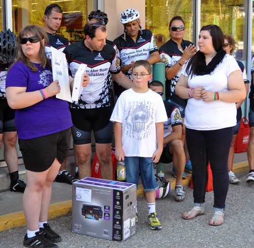 """Alicia was not alone in benefitting from the generous Cops for Kids riders. Young James Hickerson received  a computer that is going to be delivered to and installed at his home here in town. """"For me personally, as a rider this is one of the highlights"""" of being a police officer, Sharp told the crowd of spectators who gathered at Cooper's for the brief ceremony. David F. Rooney photo"""