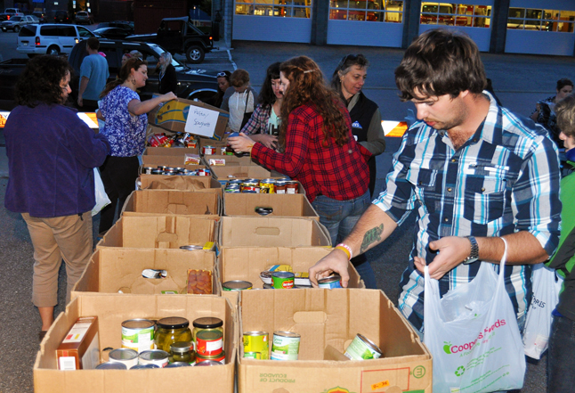 By 7:30 vehicles full of food began returning to the RCMP detachment where volunteers sorted all of the offerings into specifically labelled boxes. Canned soups in one, noodles in another and so on. David F. Rooney photo