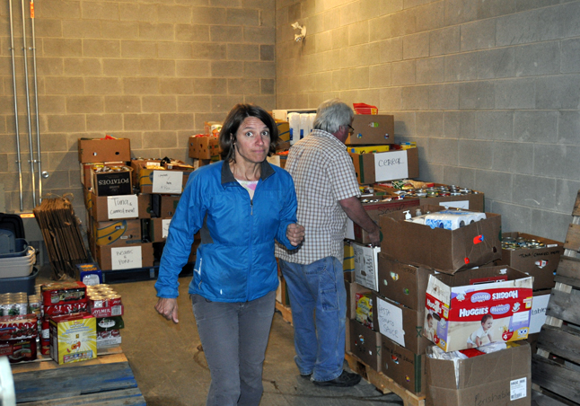 As the boxes were filled other volunteers hustled them into a storage unit at the detachment where they were kept until Friday. By noon on Friday Community Connections Food Bank Coordinator Patti Larson knew that this year's Emergency Services Food Drive was the most productive of the three that have been held since 2011 with 11,975 lbs. of donated food and $5,900 in cash donations, including from $1,000 from the Knights of Pythias, $1,000 from the Baptist Chursh and $500 from Downie Timber. The rest came in donations of $100, $50, $20 and so on. David F. Rooney photo