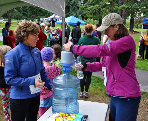 Active moms Sally Carmichel and Lisa Patry  fill up their water bottles before the start of the race.  David F. Rooney photo