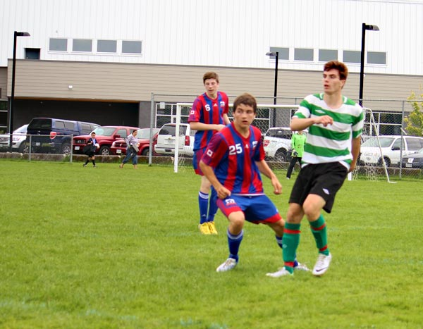Lachlan Hicks who plays for the Shuswap U17 anticipates the ball against Revelstoke's Tashie Townley, while Callum Hicks of Revelstoke is ready to challenge his brother. Linda Chell photo