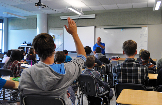 A Grade 11 student raises his hand to ask a question of MP David Wilks (center) on Friday afternoon. The Conservative MP for Kootenay Columba was at RSS to talk with students in Lisa Cancilla-Sykes' Grade 8 class and Jason Stevens' Grade 11 class about Parliament. He was also very interested in the students' questions and comments ranging from marijuana to pipeline construction. David F. Rooney photo