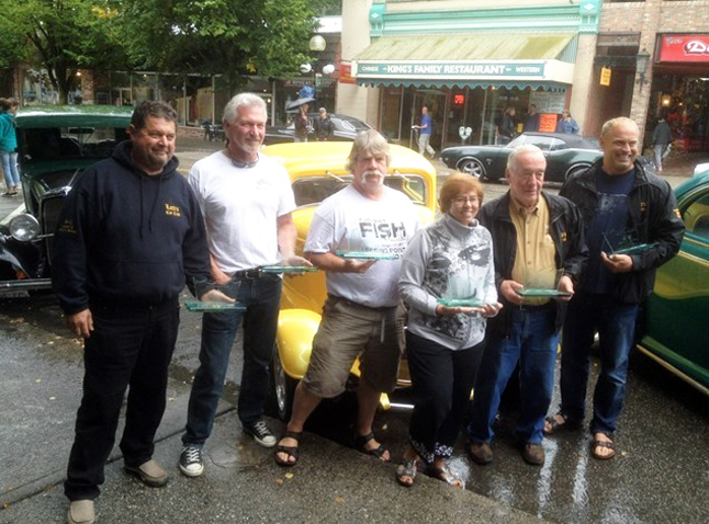 Members of the Lords Car Club pose with the awards they won at the Nelson Car Show on Labour Day. Top vehicle was Donnie Hawkers car – that's the gleaming yellow 1932 Ford in the background. He won awards for the Best Ford and Best Paint Job of the car show. Larry Presta had the Best Interior, Kenny Howe had the Best Pontiac, Rod Battersby had the Best Modified Car 60-64 and the club won an award for the being the most supportive car club of the show. Renee Howe photo