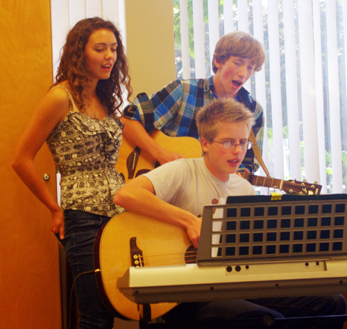 Christie, Mack and Daniel belt out a tune. Among other library events aimed at young adults is an October 25 workshop on creating graphic novels to be led by artist Bruce Thomas. Lucie Bergeron photo