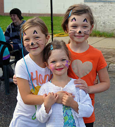 These three beaming young ladies — Violet and Ruby Riga and Alexa Powell, were very proud of their face paintings.  David F. Rooney photo