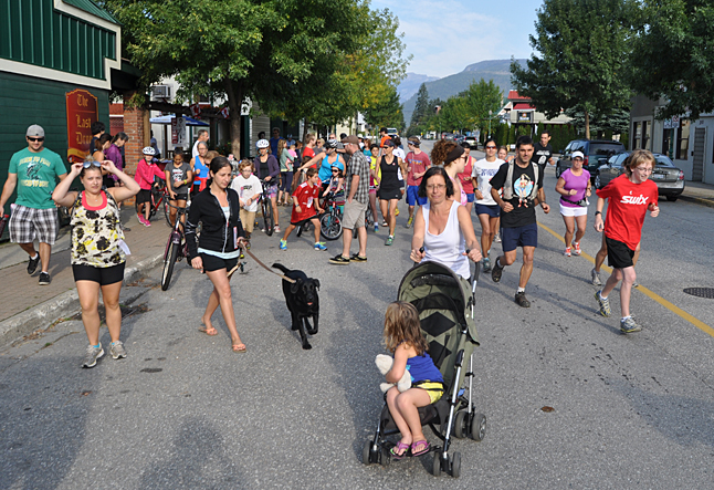 And...... they're off! All kinds of people on feet, in prams, on bikes and even with a dog or two in tow surged away from the Last Drop Patio on their way to the half-way point at Williamson's Lake on the southern edge of town. David F. Rooney photo