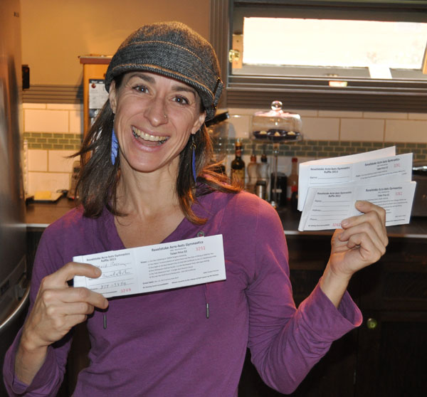Krista Cadieux at Sangha Bean cafe has something to smile about: she's selling tickets for the Revelstoke Acrobats Raffle. There are some really great prizes —a day of heliskiing with Selkirk Tangiers,  two nights accommodation at Sutton place PLUS two days of skiing at RMR, one hight at the Best Western AND $100 gift certificate for the 112 Steakhouse & Bar, A whitewater rafting trip for two with Apex Rafting, 2 Jungle Gym season passes at Sky Trek and a $50 gift certificate for the Last Tee Restaurant at the Golf Course. You can find tickets all over town. A toonie gets you ticket but — Go ahead! — be risky spend $4, $8 or $10 to maximize your chances. It's all for a good cause  supporting our award-winning gymnastics teams. David F. Rooney photo