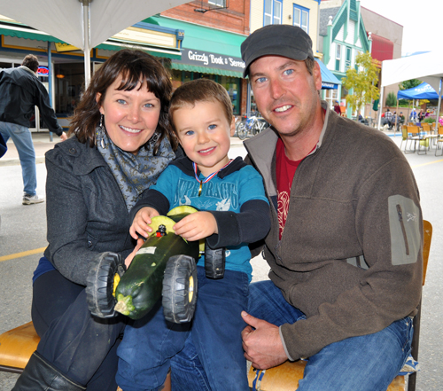 Megan McIsaac and her husband, Matt Dellow, pose with their three-year-old son Sammy who won first prize in the Zucchini Car Races on Saturday. David F. Rooney photo