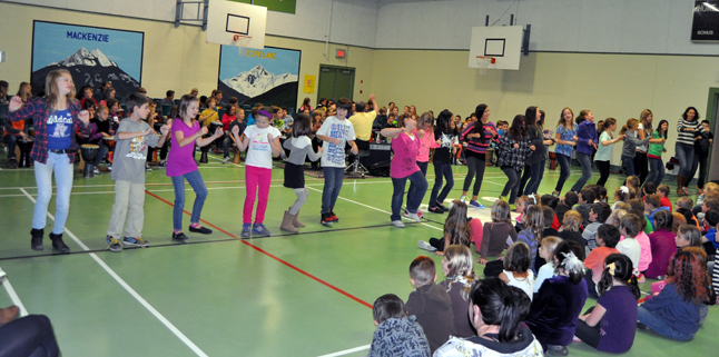 After the two-hour practice, the kids broke for lunch and then came back to perform for the younger children, parents and teaching staff. The music of the drums naturally compels people to dance and dance the older children did!. David F. Rooney photo