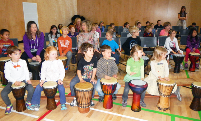 Primary kids at Begbie View drum on their bongos. Photo by student reporter-photographer Kobe Brunetti