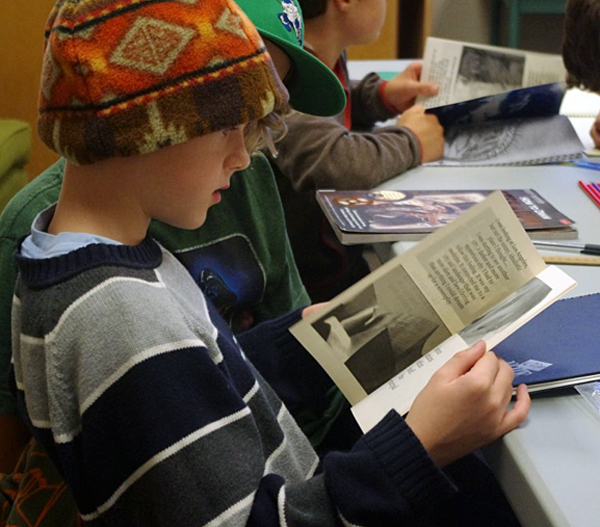 Everett Carter pages through one of Bruce's graphic novels  before setting out to create his own.Lucie Bergeron photo courtesy of the Revelstoke branch of the Okanagan Regional Library