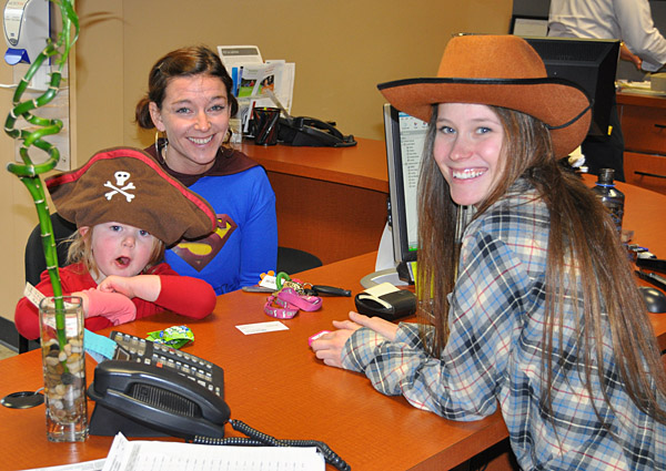 Sarah and her daughter Tayah conducted some Halloween business with Cat Bosch at the Revelstoke Credit Union's insurance services. David F. Rooney photo